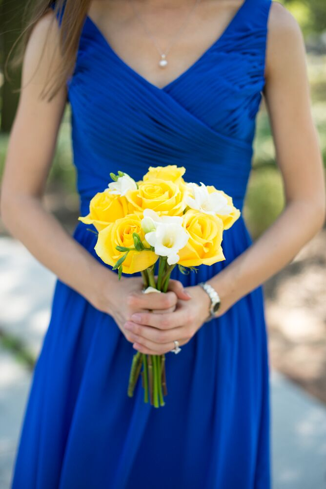 06112c5353f Britni s bridesmaids wore knee-length dresses in royal blue. To contrast  with their dresses