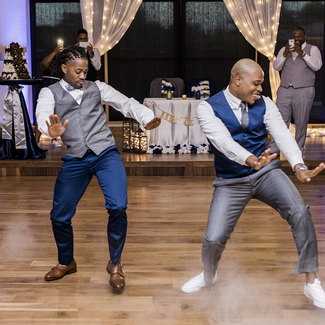 grooms on the dance floor