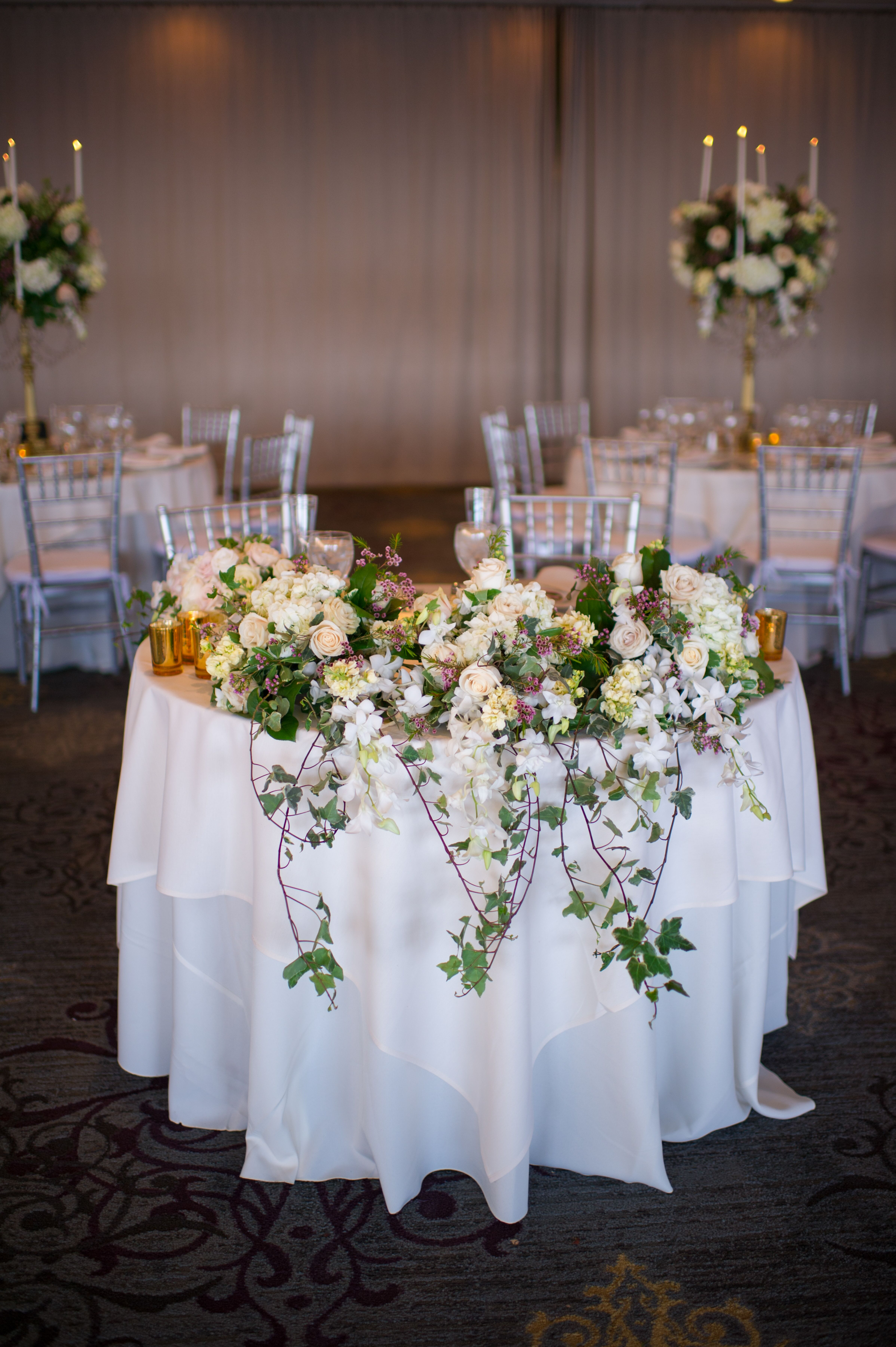 Cascading Ivy And Rose Sweetheart Table Centerpiece