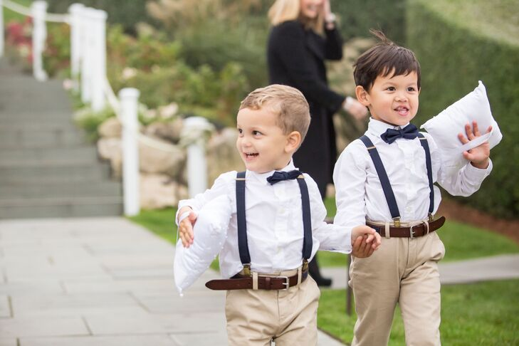 The ring bearers looked smart in their matching ensembles, the combination of khaki trousers, white button-down shirts, bowties and suspenders complementing the wedding's preppy vibe.