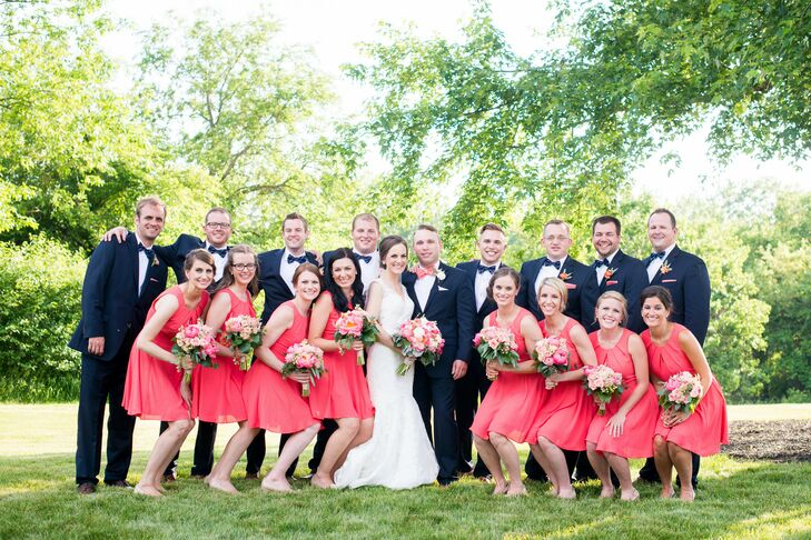 "Bridesmaids wore the coral pleated keyhole fit-and-flare dress from Express. ""Nathan and I wanted to take a practical route with our bridal party and help them save money and have something they could wear again,"" Renee says. ""I found our bridesmaid dresses at Express and the girls were able to buy the dresses during a sale."""