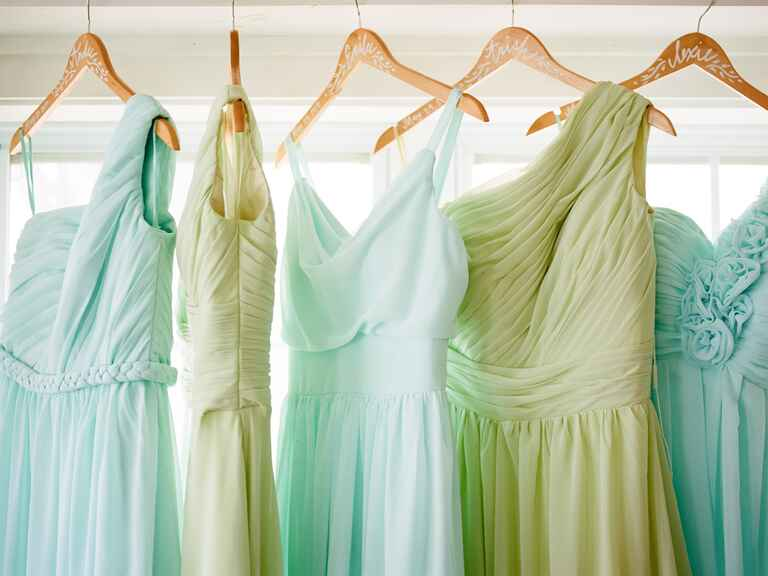 Hanging blue and green bridesmaids dresses