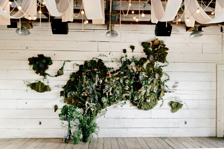 One of the most eye-catching and unique elements of Marion and John's reception was the living moss wall created by their floral designer. Consisting of moss, succulents and botanicals, the arrangement was displayed next to the dance floor.
