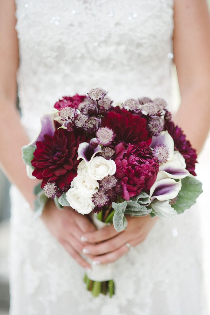 Kimberly held a bouquet filled with burgundy dahlias and peonies, purple and white calla lilies and white roses accented with dusty miller. The only guidelines the couple gave their florist was that they wanted Picasso calla lilies and didn't want any baby's breath.
