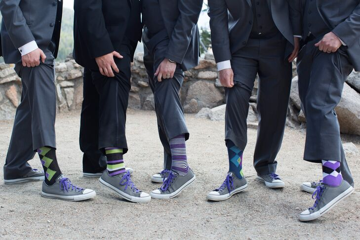 Joe and his groomsmen ditched tradition when it came to their accessories, swapping out classic black dress shoes for laid-back converse kicks with colorful laces.