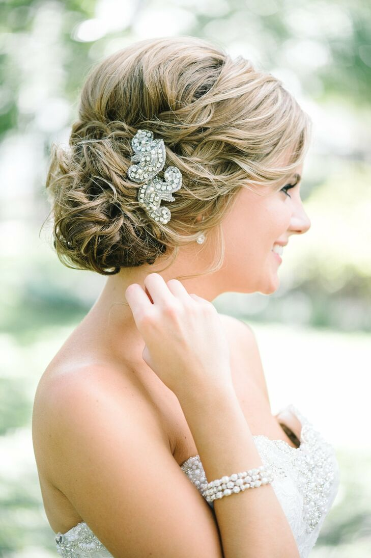 Tara added a hint of glam to her curled updo with a crystal and bead embellished hair clip.