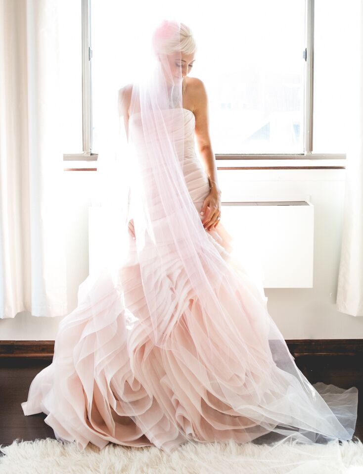 Blush pink strapless wedding gown and bride with pink hair