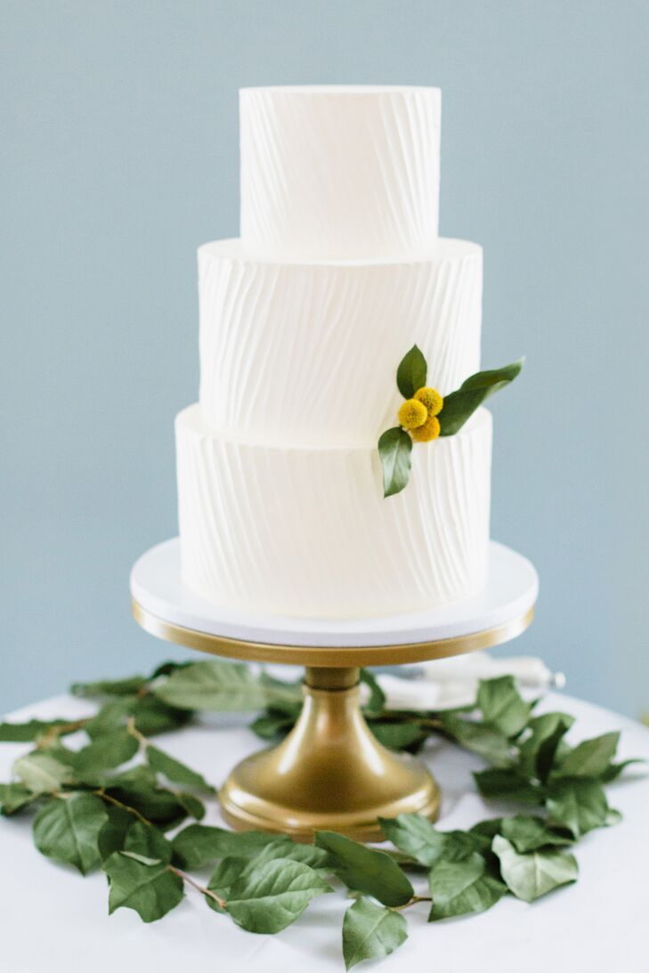 Earth and Sugar bakery crafted Wes and Jay's simple white wedding cake, which was accented with a single yellow billy ball.
