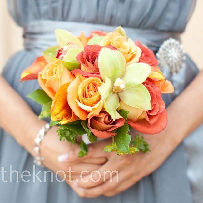 The bridesmaids carried bouquets similar to Jo Anne's but with more orange, including roses and cymbidium orchids.