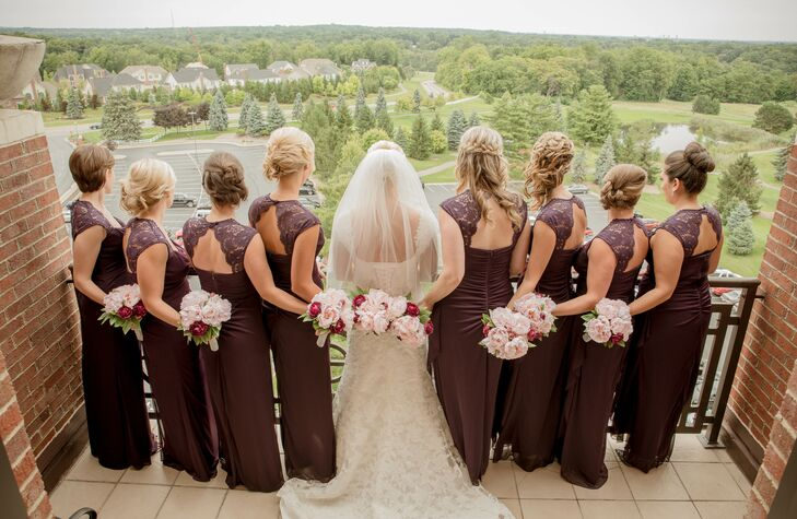 Ashleigh's bridesmaids paired their dark plum dresses with elegant updos for a fun, yet elegant, look.
