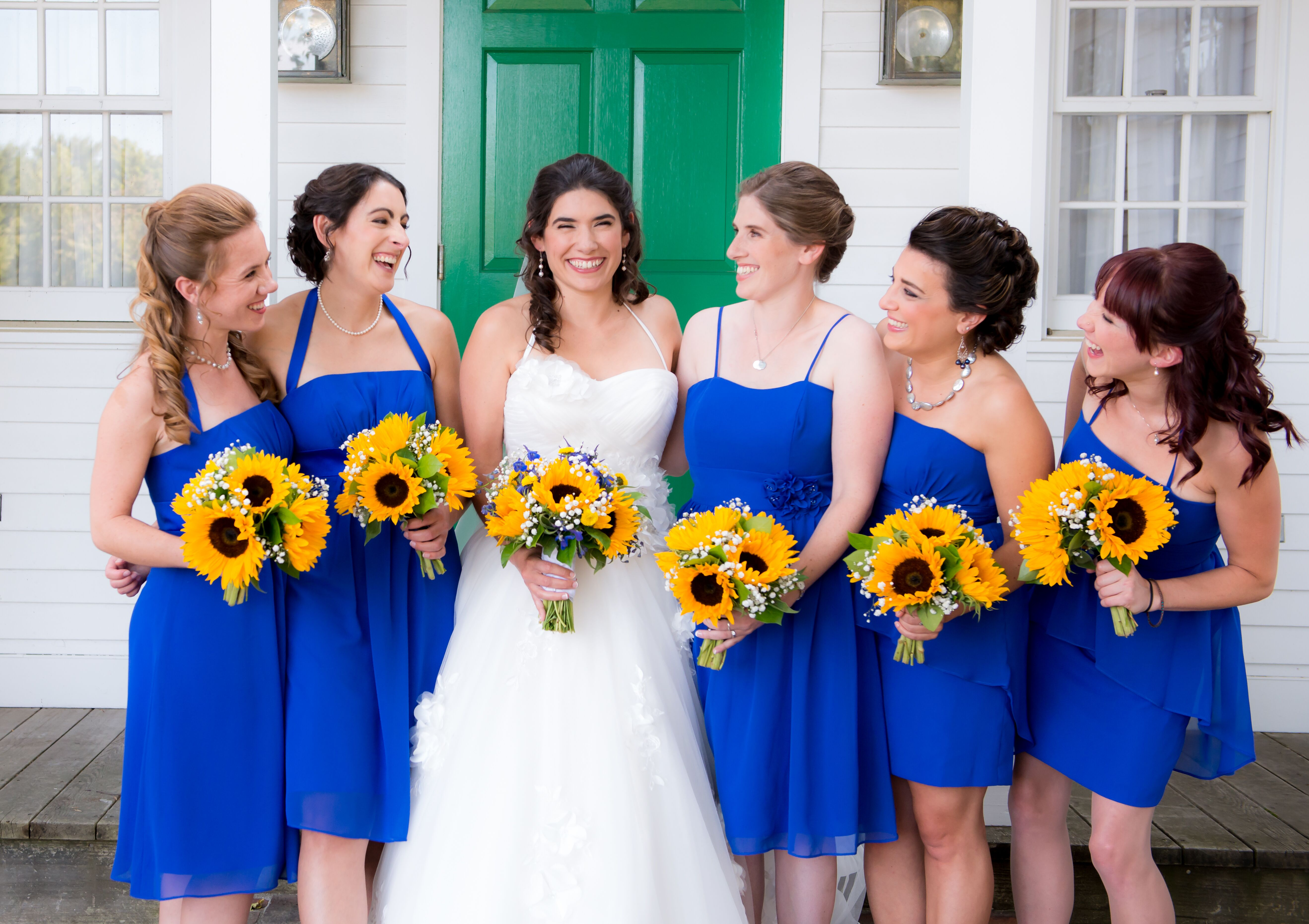 Bridesmaids In Royal Blue Cocktail Dresses With Sunflower