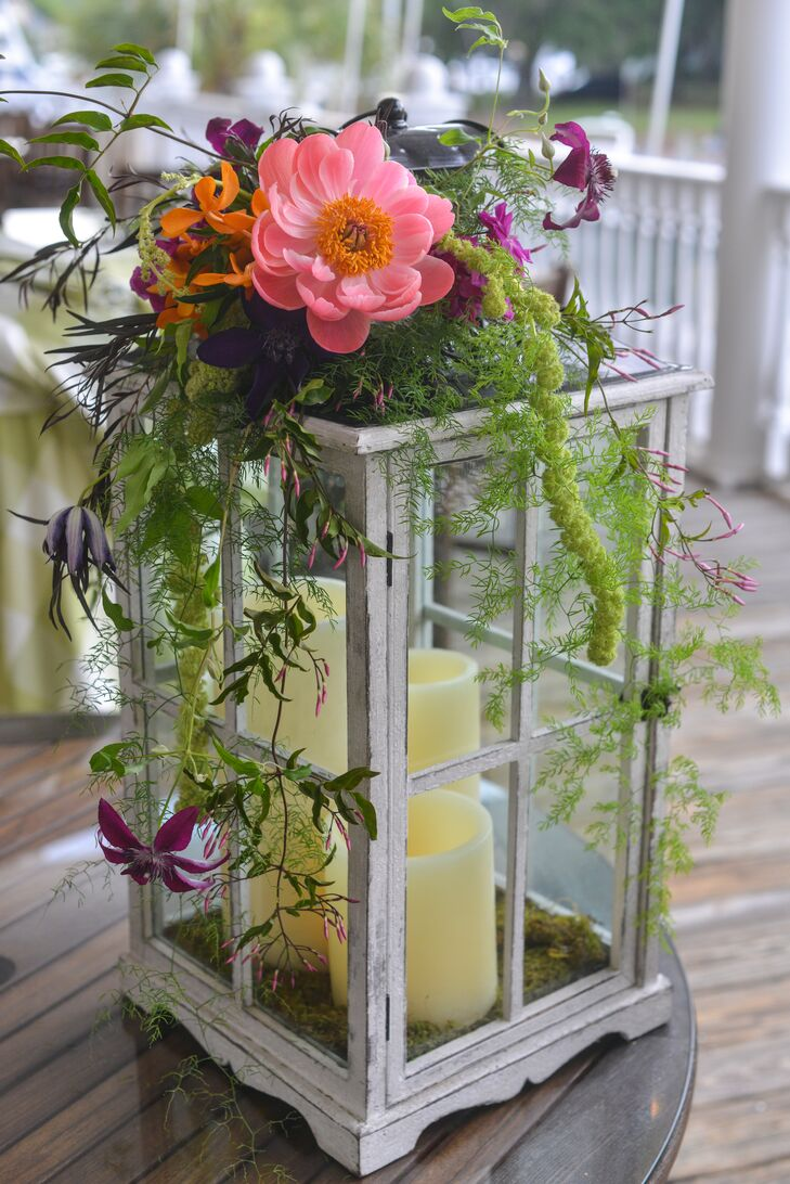 Lantern centerpiece with fresh flower accents