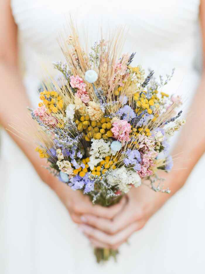 Rustic bridal bouquet made of grains and grasses