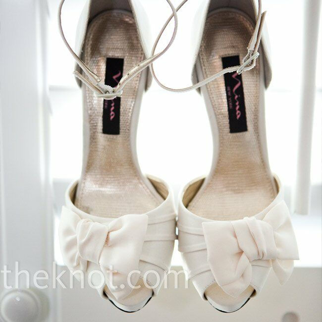 After the beachside ceremony, Andrea slipped on a lovely pair of ivory peep-toe heels adorned with bows across the toes.