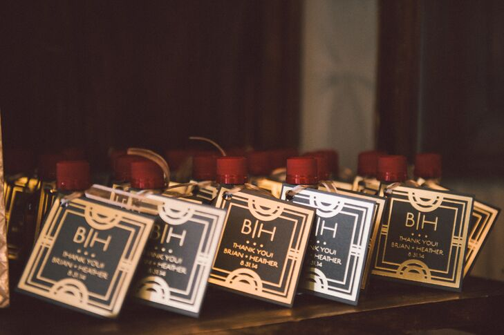 Inspired by their venue, the couple dreamed up a fun, festive and glam speakeasy theme for their wedding. While the venue itself packed plenty of Prohibition-era charm, Heather and Brian played up the theme, with 1920s cocktails and miniature bottles of whiskey for the wedding favors, decorated with black-and-gold art-deco-inspired gift tags.