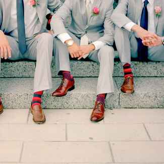 Groom and groomsmen wearing fun wedding socks