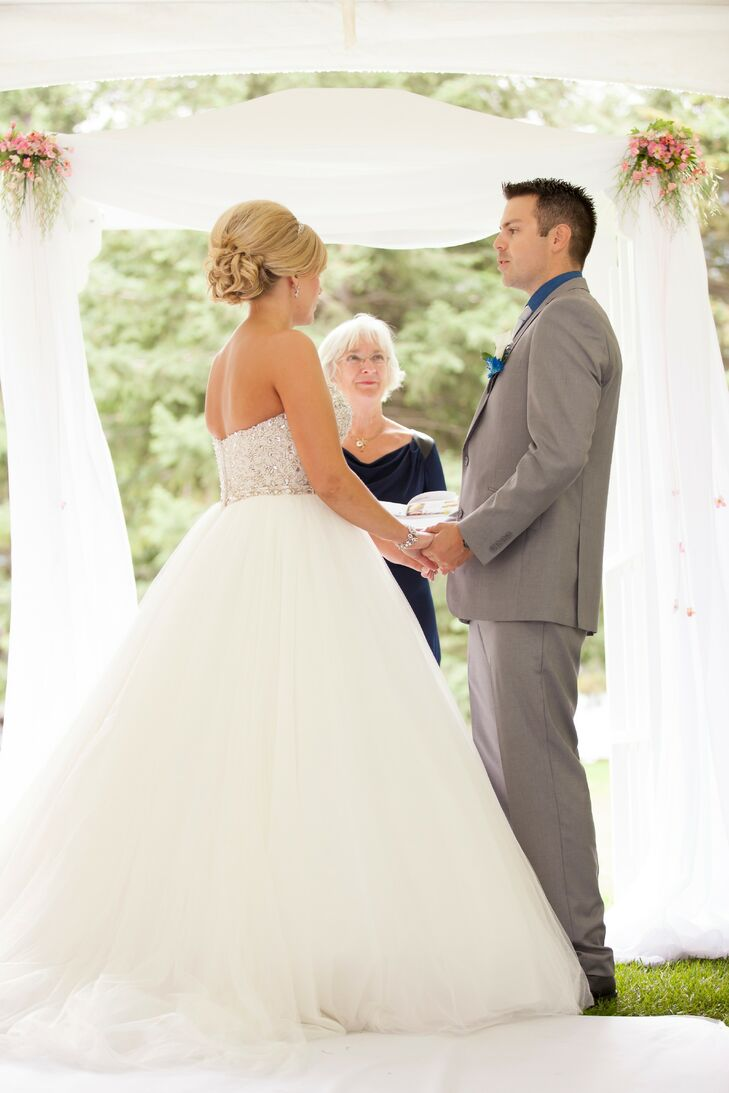 White Draped Arch for Outdoor Ceremony