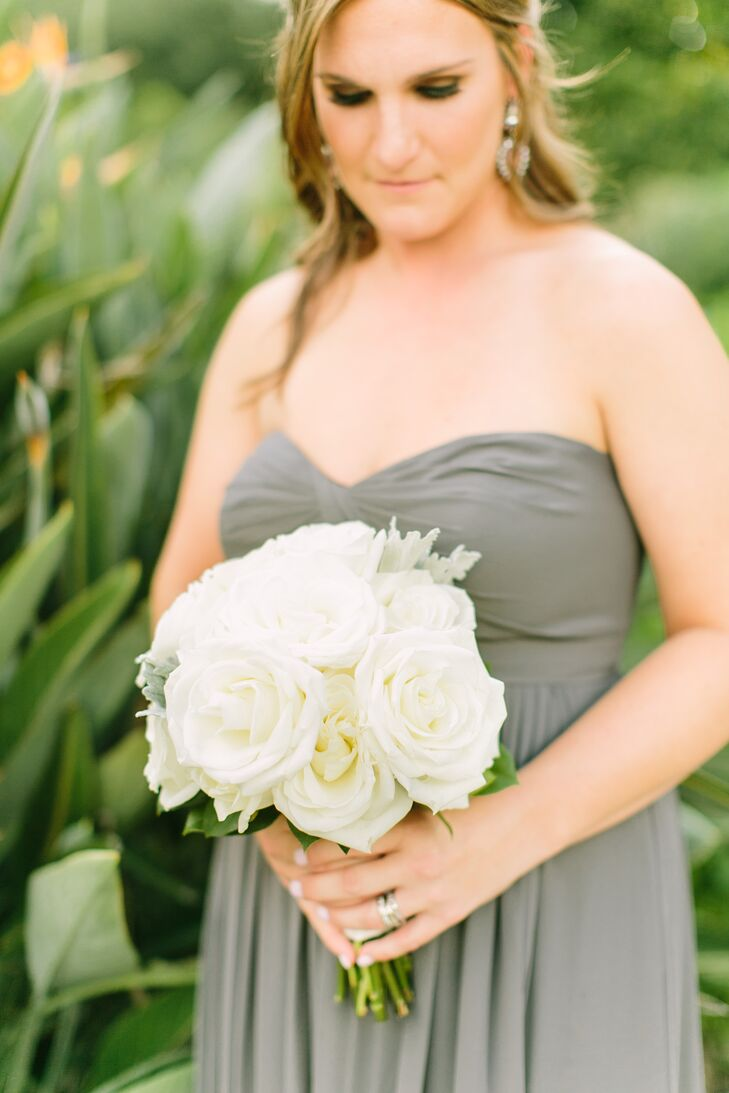 The bridesmaids carried white roses with dusty miller that matched the groomsmen's boutonnieres. Chelsea and Aaron loved how the stunning florals were neutral and natural to match the clean, chic, formal theme.