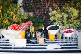Bellini bar with strawberries, raspberries and blackberries
