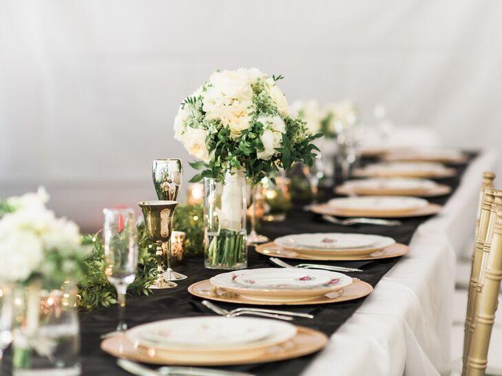 Instead of numerous floral centerpieces, Kassi opted for simple green garlands wrapped with fairy lights.