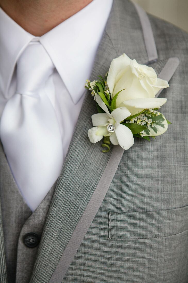 White Rose And Wax Flower Boutonniere