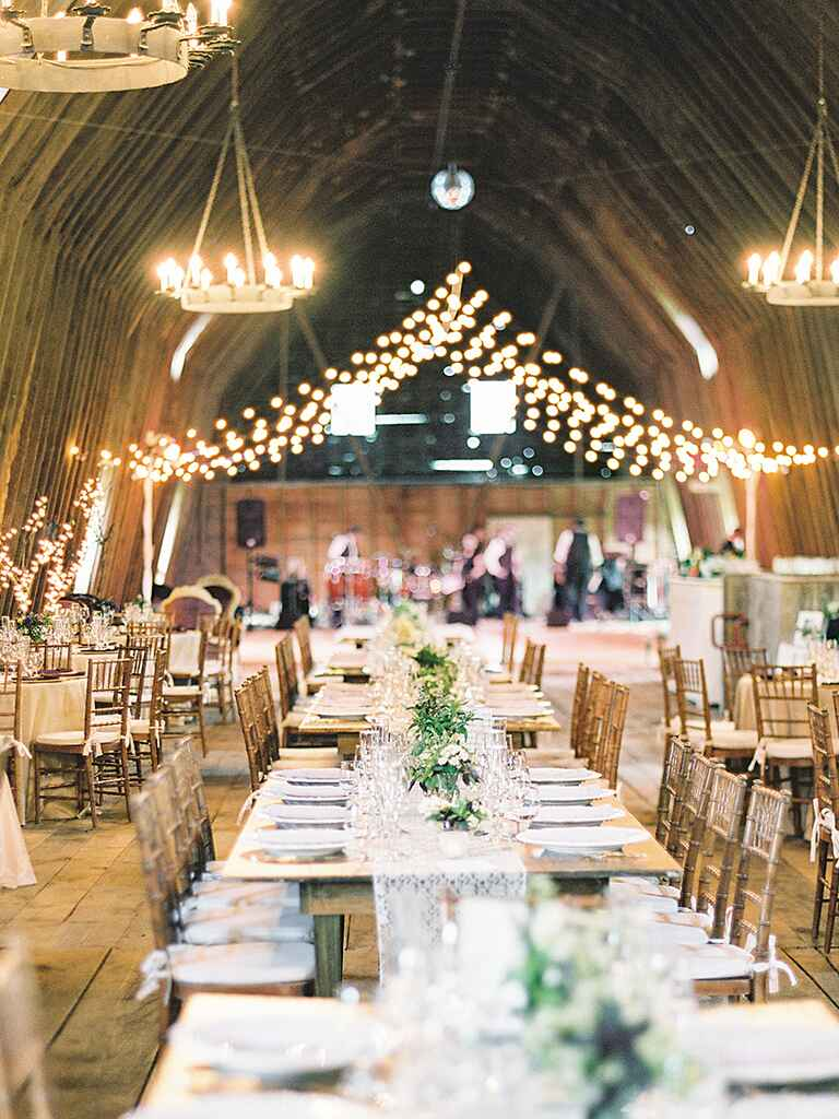 Family-style tables and round tables for a rustic wedding reception