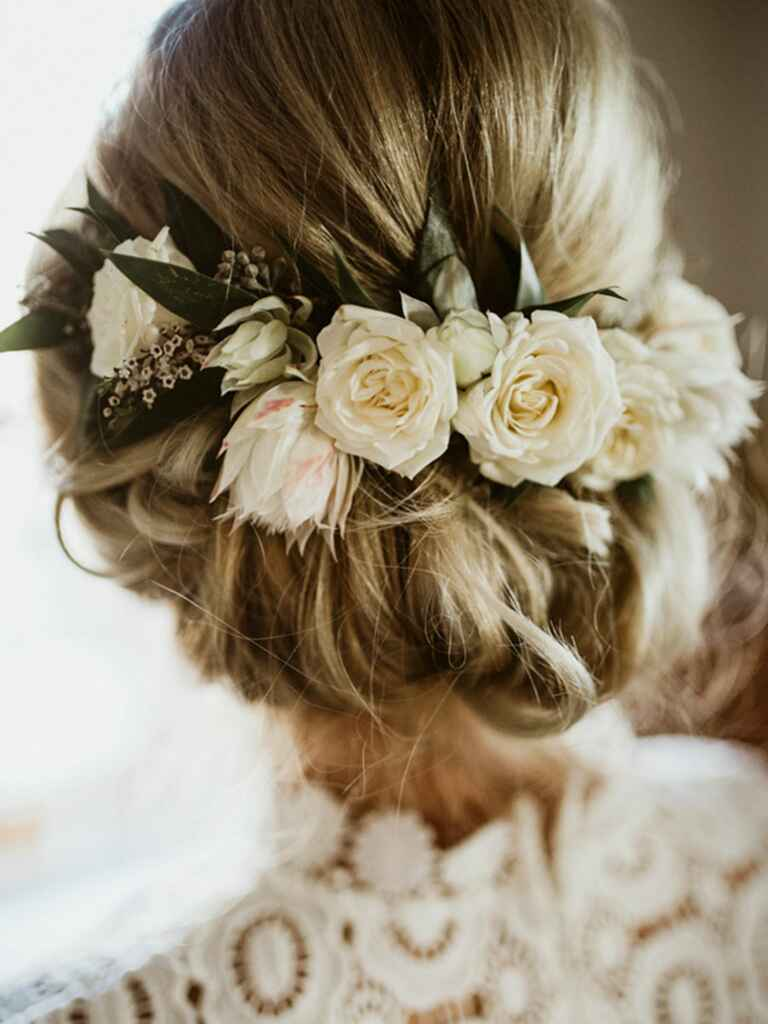 Wedding hairstyle low updo with flower crown.