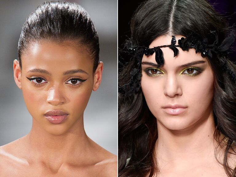 One model with a smoky metallic eye from the Versace show and the other with a black cat eye from the Oscar De La Renta runway show