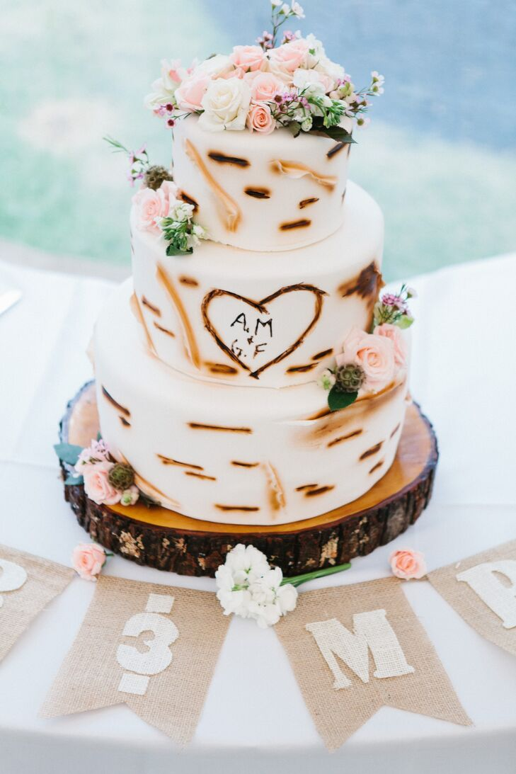 The pumpkin-spice-flavored wedding cake was frosted with fondant designed to resemble birch bark.