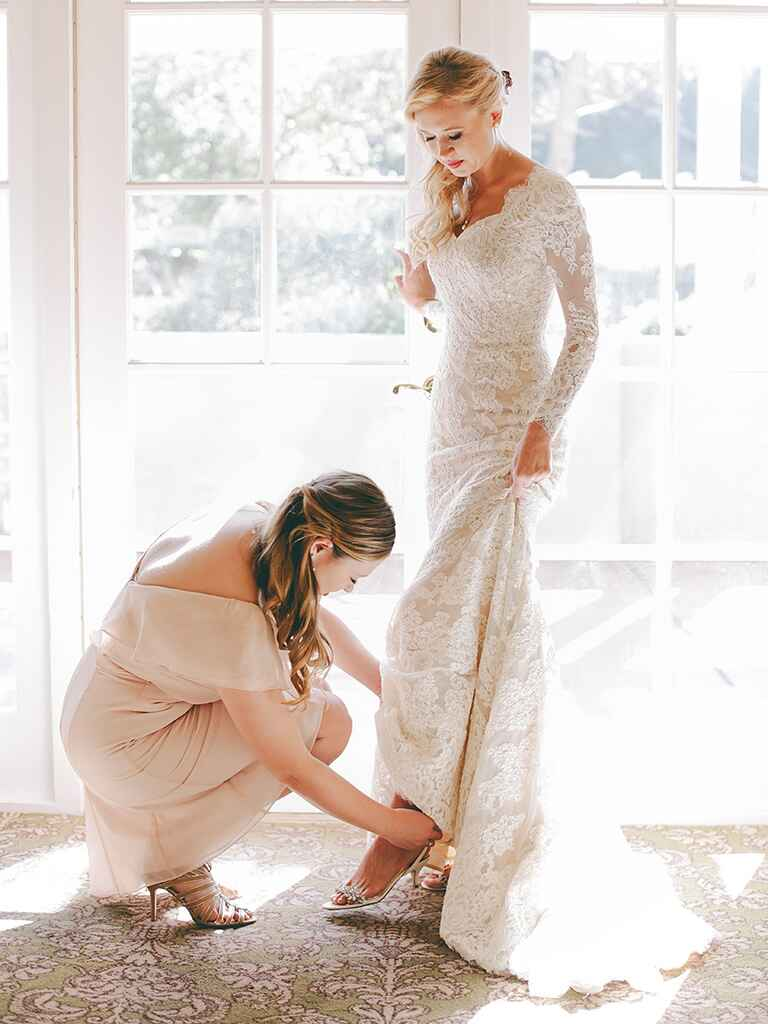Long sleeved lace Anne Barge wedding gown