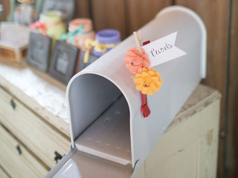 Gray Wedding Card Mailbox With Pink And Orange Flower Flag On Reception Table