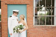 Kathryn Bentley (25 and an adjunct instructor) and Andrew Butler (27 and a Naval Intelligence Officer) fused a pastel color palette with soft linens a