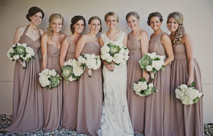 Full length taupe bridesmaid dresses and cabbage flower bouquets