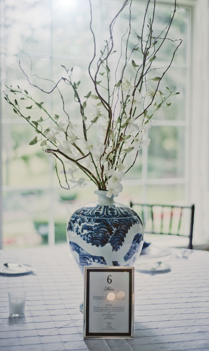 White and Blue Vase Centerpiece with Tall Orchids