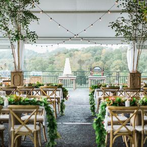 Tented Reception with String Lights and Birch Tree Planters & Tented Weddings