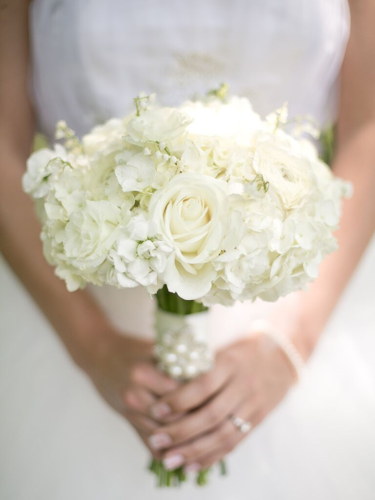 A Classic White Wedding Bouquet With Lily Of The Valley Hydrangea And Roses