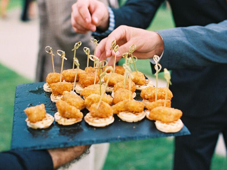 Hands reaching for hors d'oeuvres at a wedding