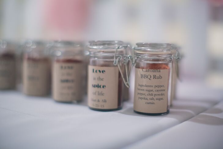 "Guests went home with homemade Carolina barbecue spice rub. The front of the glass jars said ""Love is the spice of life,"" with Alli and Matt's names and wedding date."
