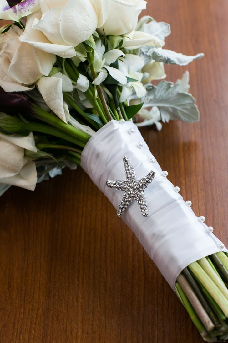 A starfish motif was used throughout the day's decor—from the invitations to the bride's bouquet.