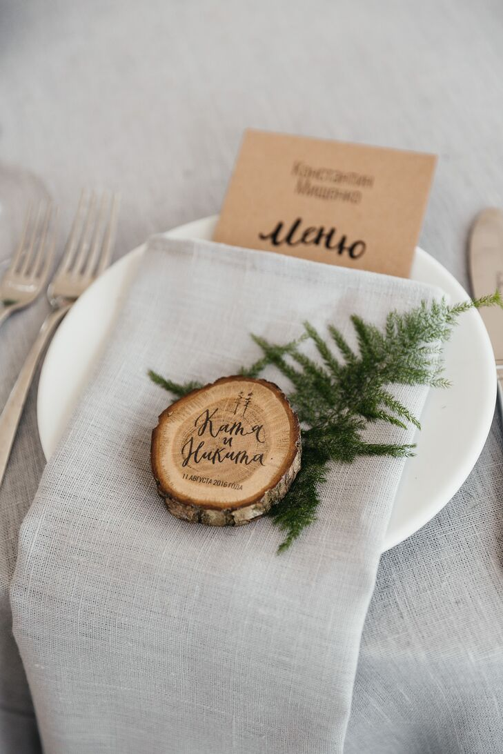 As gifts for friends and family who joined them on their special day, Katya and Nikita made wooden coasters and decorated them with their names and their wedding date.