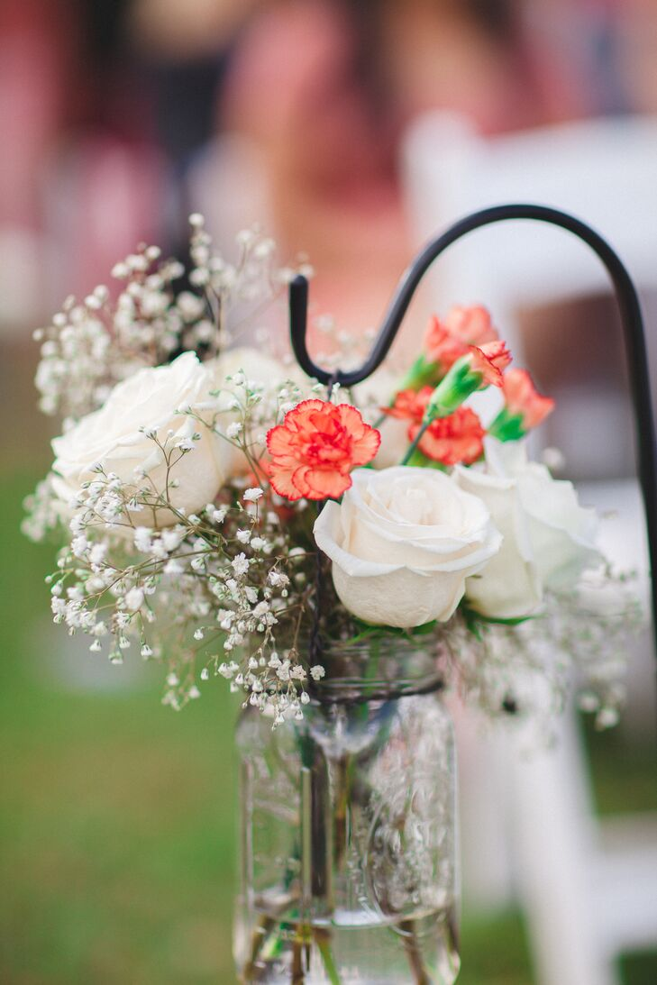 Aisle decorations of mason jars with white and coral flowers mightylinksfo