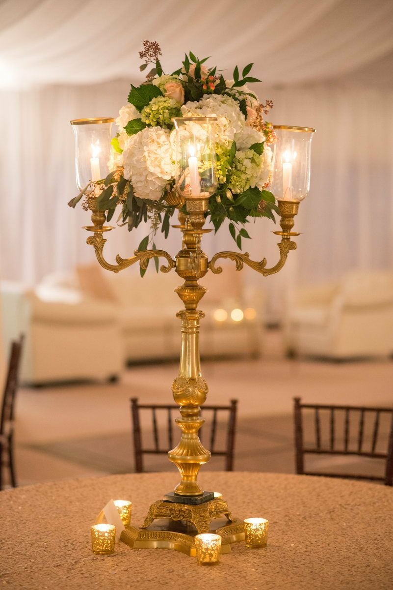 Gold candelabra centerpieces with hydrangea