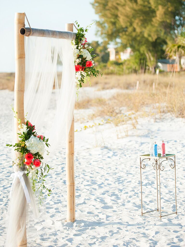 A simple bamboo and sheer fabric arch perfect for a beach wedding & 19 Ideas for an Outdoor Wedding Arbor