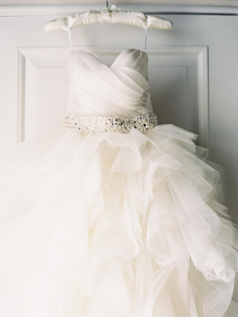 Ruffled tulle wedding dress on silk hanger