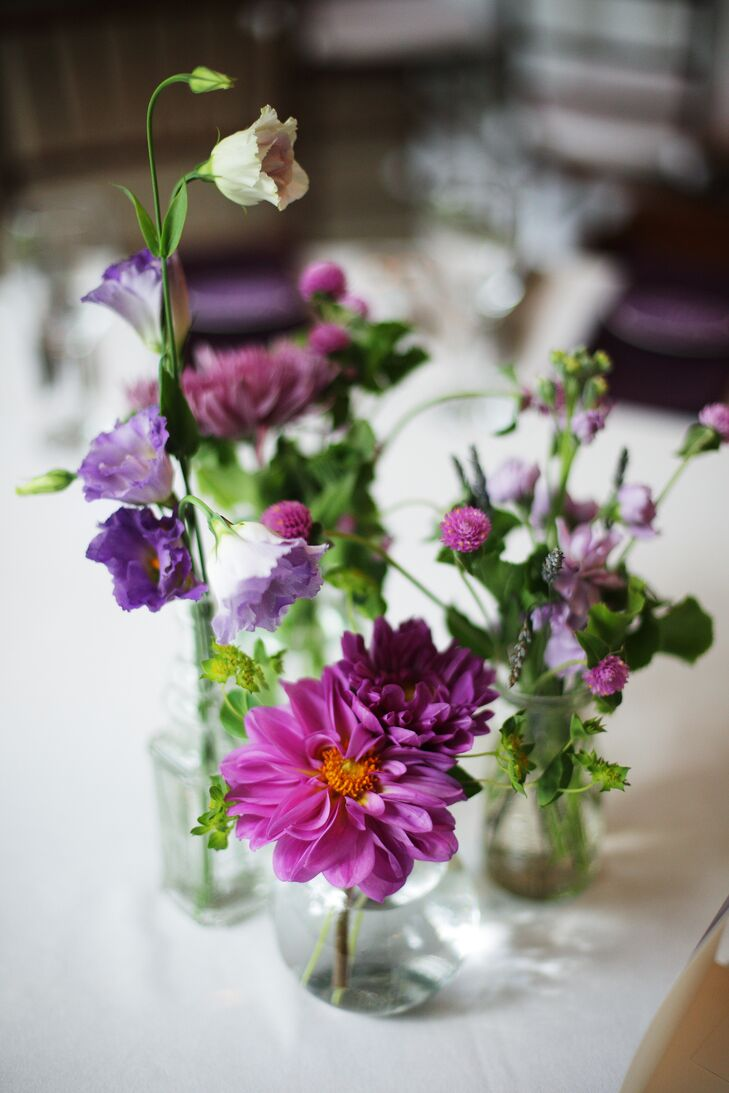 Centerpieces at the reception were simple, with various arrangements of purple chrysanthemums, dahlias and wildflowers in small glass vases.