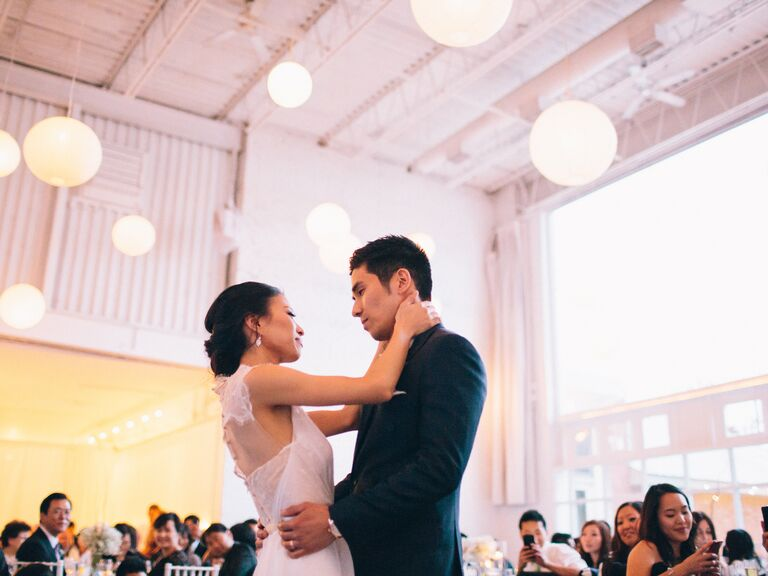 Bride and groom first dance in indoor reception venue