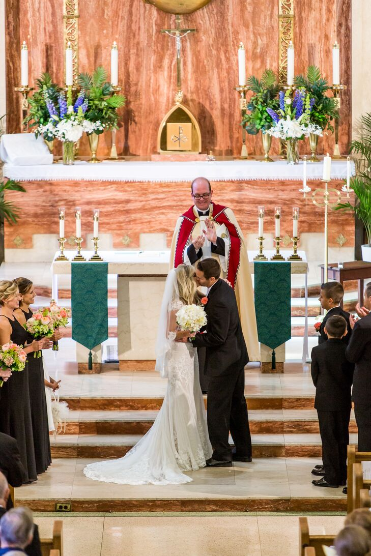 Stephanie and Marc loved the marble detailing and gold accents of St. Joseph Catholic Church. Since the church was naturally gorgeous on its own, they kept decor to a minimum and let the venue speak for itself.