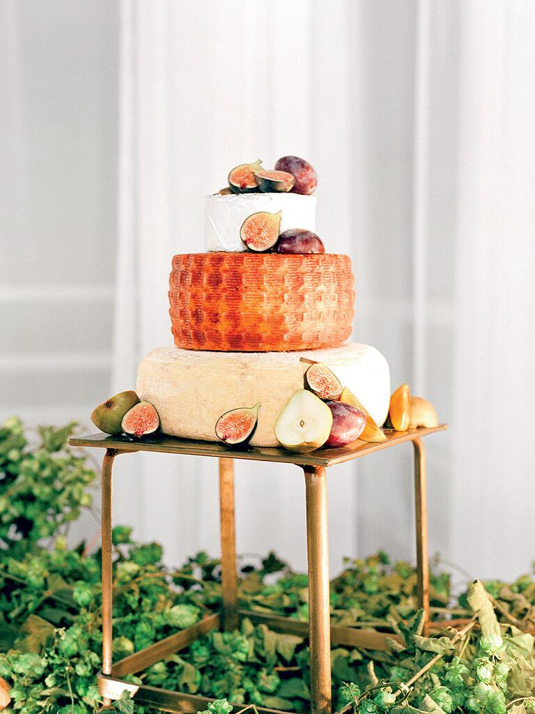 Cheese wheel wedding cake with pears and figs