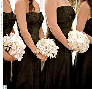 Each bridesmaid donned a black strapless dress and had different bouquets of white blooms. The groomsmen wore pinstripe ties and floral and feather boutonnieres.