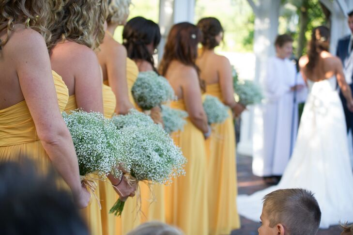 Bridesmaids in Yellow Dresses with Baby's Breath Bouquets